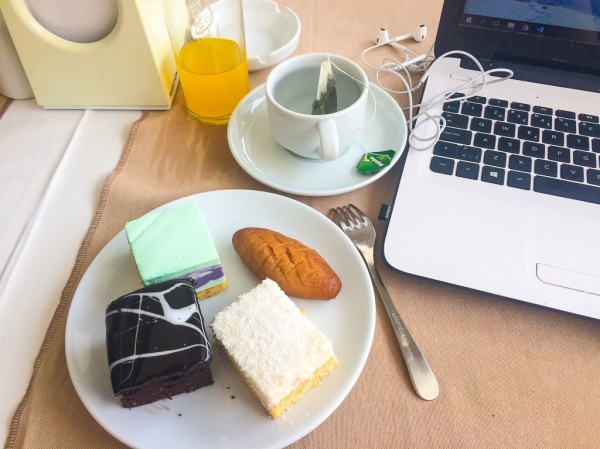 Blogger writing with food