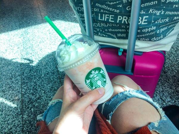 blogger drinking Starbucks